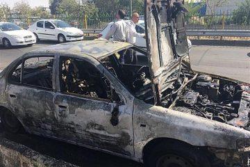 آتش گرفتن خودرو سمند در بزرگراه کرج/تصویر